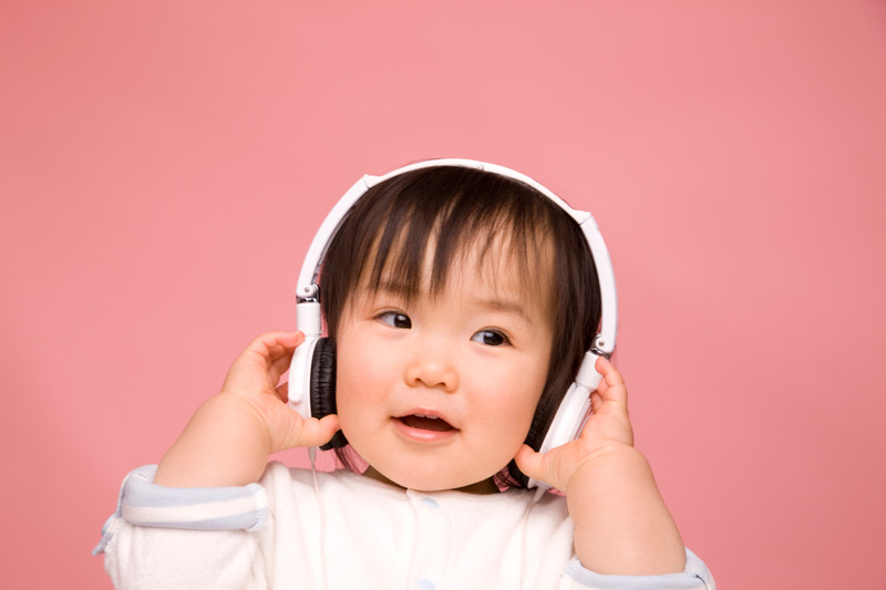 Girl wearing headphones.